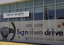 "Owens Murphy ""Sign then drive"" window graphic"
