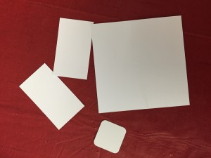 Examples of invisible ink on a variety of stock sizes and shapes.